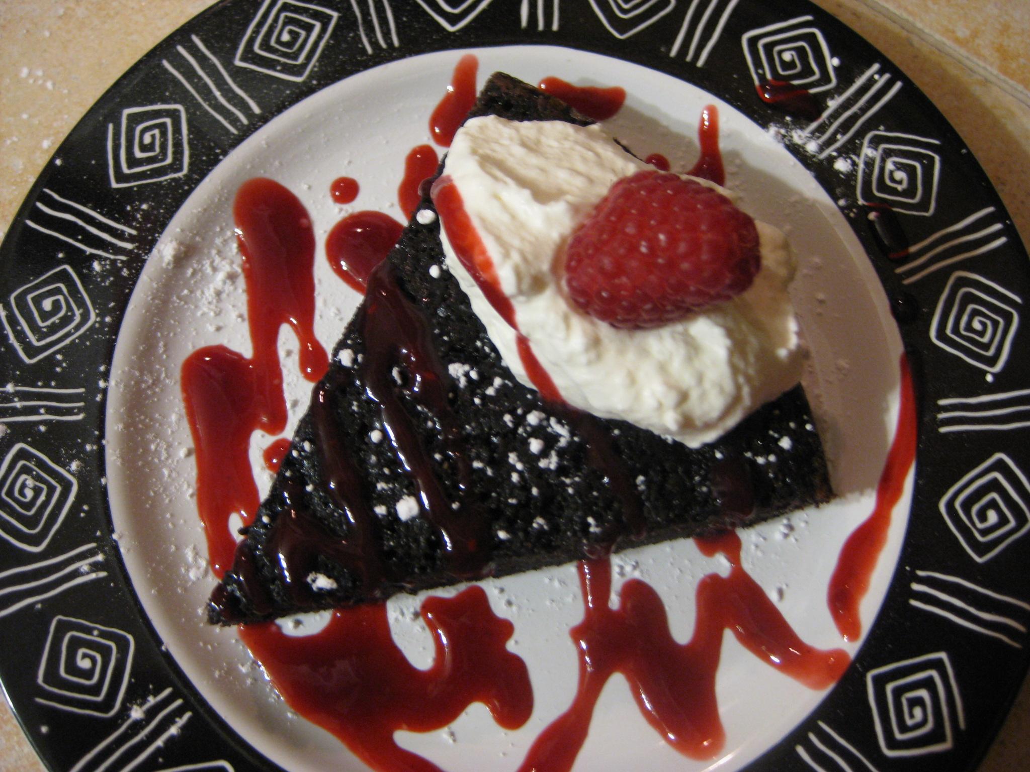 Chocolate Cake wRaspberry Sauce and White Chocolate Whipped Cream